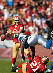 Dec 27, 2009; San Francisco, CA, USA;  Detroit Lions defensive end Cliff Avril (92) dives of a block from San Francisco 49ers running back Frank Gore (21) to put pressure on quarterback Alex Smith (11) during the second quarter at Candlestick Park. San Francisco defeated Detroit 20-6.