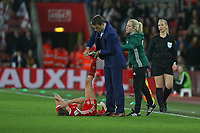 Football - 2017 / 2018 Womens World Cup Qualifier - UEFA Group One: England vs. Wales<br /> <br /> England Head Coach Phil Nevillie helps stretch out cramp on a Welsh player at St Marys Stadium<br /> <br /> COLORSPORT/SHAUN BOGGUST