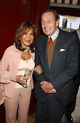MINDA FELICIANO and her husband NORMAN LONSDALE at a private view of paintings by singer Tony Bennett held at the catto Gallery, 100 Heath Street, London NW3 on 5th April 2005.<br />