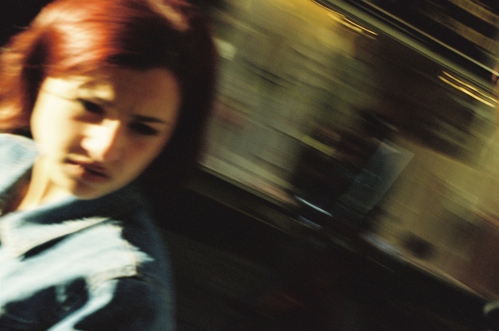 A woman rides a Vespa in central Naples, 1998.