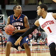 Tracy Abrams #13 of the Illinois Fighting Illini keeps the ball from Maurice Watson Jr. #1 of the Boston University Terriers during the NIT First Round game at Agganis Arena on March 19, 2014 in Boston, Massachusetts . (Photo by Elan Kawesch)