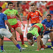 Ed Fidow and his Manu Samoa teammates relished their ferocious defensive play vs. Portugal in their 28-12 victory at the Singapore 7's, day 1, Singapore National Stadium, Singapore.  Photo by Barry Markowitz, 4/16/16