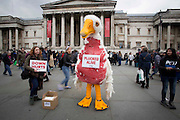 Photographer: Rick Findler<br /> <br /> 04.04.15 A massive pillow fight breaks out in Trafalgar Square, London this afternoon for International Pillow Fight Day. Thousands of people gathered in the capitals square for the annual event, which takes place in cities across the world. <br /> Pictured - A PETA member in a giant plucked-goose costume watches on in protest of down-feather pillows.