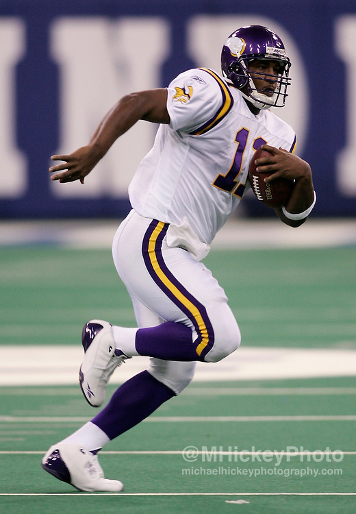 Minnesota quarterback Duante Culpepper scrambles out of the pocket during action against Indianapolis at the RCA Dome in Indianapolis, In Nov 8, 2004. The Colts beat the Vikings 31-28.