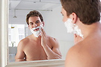 Barechested Man Shaving