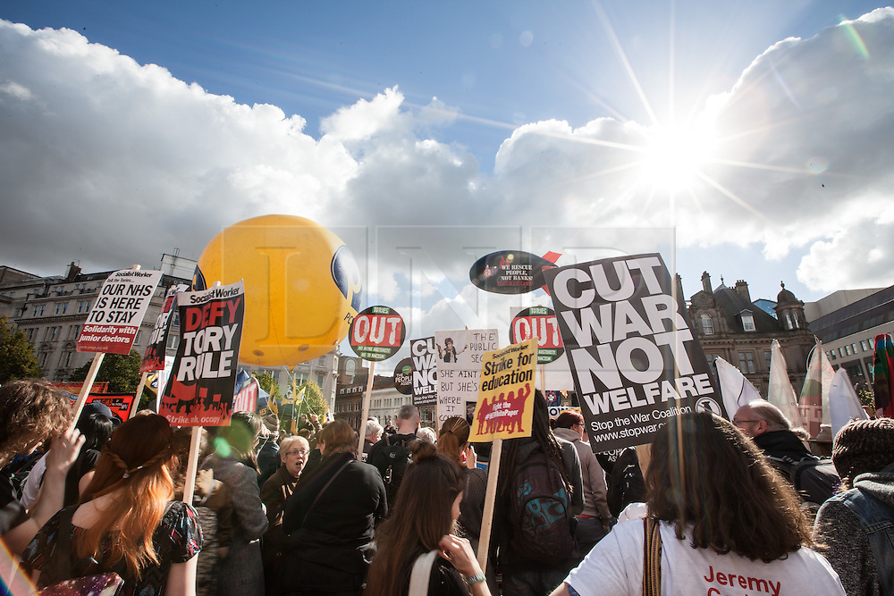 © Licensed to London News Pictures. 02/10/2016. Birmingham, UK. Protesters rally in Victoria Square at the People's Assembly national demonstration against the policies of Britain's Conservative government. The Conservative Party conference begins today at the ICC in Birmingham and is the first under the leadership of Prime Minister Theresa May, who took over after David Cameron's resignation in July 2016. Photo credit: Rob Pinney/LNP