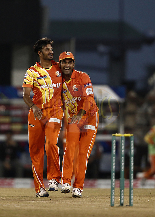 Aizaz Cheema of the LAHORE LIONS and Mohammad Hafeez Captain of the LAHORE LIONS celebrates the wicket of Tillakaratne Sampath of the SOUTHERN EXPRESS during the qualifier 5 match of the Oppo Champions League Twenty20 between the Southern Express and the Lahore Lions held at the Chhattisgarh International Cricket Stadium, Raipur, India on the 16th September 2014<br /> <br /> Photo by:  Deepak Malik / Sportzpics/ CLT20<br /> <br /> <br /> Image use is subject to the terms and conditions as laid out by the BCCI/ CLT20.  The terms and conditions can be downloaded here:<br /> <br /> http://sportzpics.photoshelter.com/gallery/CLT20-Image-Terms-and-Conditions-2014/G0000IfNJn535VPU/C0000QhhKadWcjYs