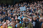 Manchester City defender Vincent Kompany (4) banner in crowd during the Barclays Premier League match between Manchester City and Manchester United at the Etihad Stadium, Manchester, England on 20 March 2016. Photo by Phil Duncan.