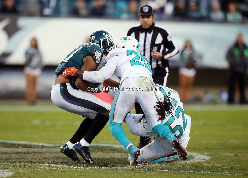 Philadelphia Eagles wide receiver Jordan Matthews (81) gets tackled short of a first down on a fourth down play by Miami Dolphins strong safety Reshad Jones (20) and Miami Dolphins middle linebacker Kelvin Sheppard (52) on a fourth quarter play that clinches the win during the 2015 week 10 regular season NFL football game against the Miami Dolphins on Sunday, Nov. 15, 2015 in Philadelphia. The Dolphins won the game 20-19. (©Paul Anthony Spinelli)