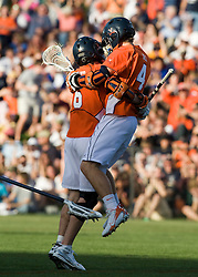 Virginia attackman Ben Rubeor (6) celebrates with Virginia attackman Gavin Gill (4) after scoring against Duke.  The #3 ranked Virginia Cavaliers fell to the #2 ranked Duke Blue Devils 19-9 at the University of Virginia's Klockner Stadium in Charlottesville, VA on April 12, 2008.