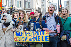 London, UK. 15th April 2019. Climate campaigners from Extinction Rebellion begin 'International Rebellion UK - Shut Down London!' events at Oxford Circus alongside the Ship of Truth to call on the Government to take urgent action to address climate change.
