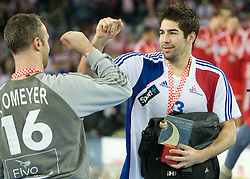 Goalkeeper of France Thierry Omeyer and Nikola Karabatic (13) of France after the 21st Men's World Handball Championship 2009 Gold medal match between National teams of France and Croatia, on February 1, 2009, in Arena Zagreb, Zagreb, Croatia. France won 24:19 and became World Champion 2009.  (Photo by Vid Ponikvar / Sportida)