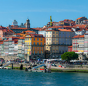 Colourful houses of Ribeira district in the old town of Porto, Portugal as seen from across the Douro River from Vila Nova de Gaia