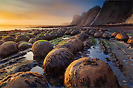Sunset light on geological concretions at Bowling Ball Beach; Mendocino County; California