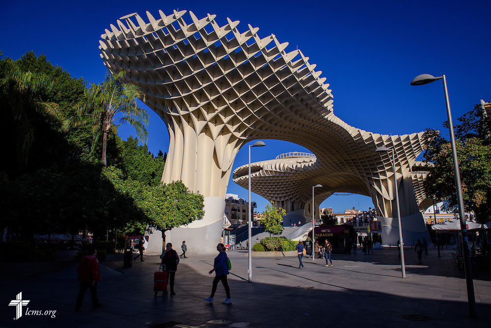 Residents and tourists stroll past the Metropol Parasol on Monday, Nov. 7, 2016, in Seville, Spain.  LCMS Communications/Erik M. Lunsford