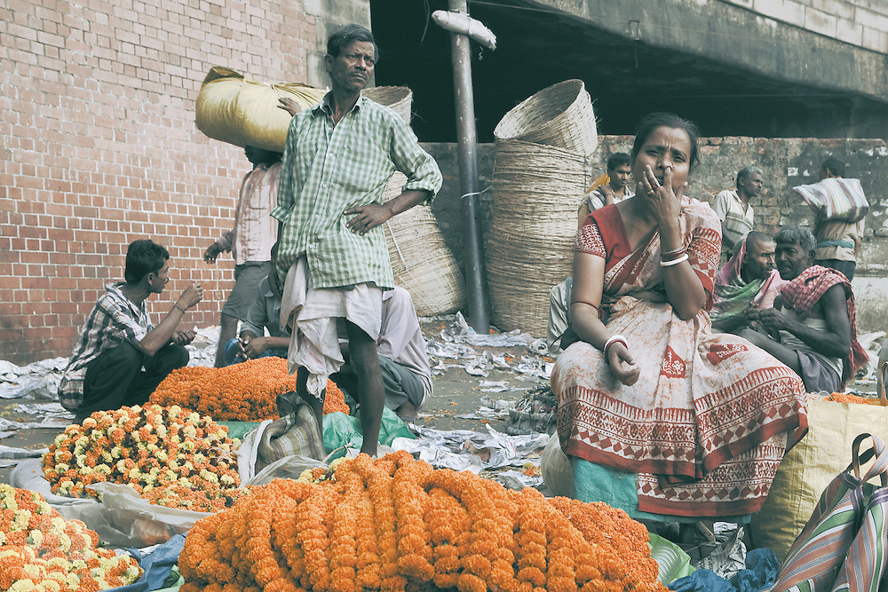 Vendors at Mullik Ghat flower market, Kolkata, West Bengal, India.<br />