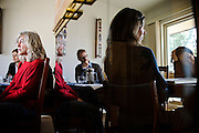 (photo by Matt Roth)<br /> Friday, March 2, 2012<br /> <br /> University of Maryland College Park, Department of Art History and Archaeology faculty members held a retreat at the home of fellow faculty member Dr. Shannen Hill, foreground left, in Hyattsville, MD Friday, March 2, 2012. Other faculty members in the photograph are (L-R) Dr. Meredith Gill, Dr. Joshua Shannon, Dr. Alicia Volk, and Dr. Yui Suzuki.