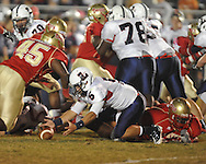 Lafayette High's D.Q. Reynolds (63) forces a fumble vs. Lewisburg in Homecoming football action in Oxford, Miss. on Friday, September 30, 2011. Lafayette High won 42-0 for the team's 23rd straight win.