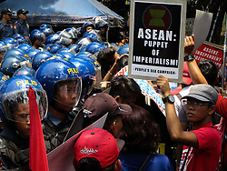 April 29, 2017 - Philippines - A protester, right, holds a placard, as police block protesters from reaching the venue of the Association of Southeast Asian Nations (ASEAN) Leaders Summit during a rally in Manila, Philippines on Saturday. (Credit Image: © Richard James Mendoza/Pacific Press via ZUMA Wire)