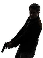 one man killer policeman holding gun silhouette studio white background