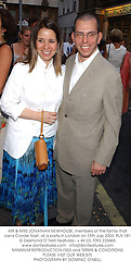 MR & MRS JONATHAN NEWHOUSE, members of the family that owns Conde Nast, at a party in London on 15th July 2003.PLN 181