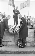 Dr. Alf Murray (left) outgoing President of the GAA assisting Mr Seamus Ryan, newly elected President laying a wreath in the garden of remembrance after his election of GAA at the Annual conference in Dublin this weekend...Annual Congress, GAA. 26.3.1967. 26 March 1967