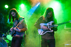 © Licensed to London News Pictures. 04/04/2014. Rotterdam, Netherlands.   Quilt performing live at Motel Mozaique Festival.  In this picture - Shane Butler (right).  Quilt are a three-piece psychedelic indie-rock band from Boston consisting of Anna Fox Rochinski (vocals/guitars), Shane Butler (vocals/guitars) and John Andrews (vocals/drums). Motel Mozaïque is an annual music/arts festival, held annually in Rotterdam, Netherlands.  Photo credit : Richard Isaac/LNP