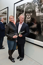 PETER & SOPHIE THOMPSON at a private view of photographs by wildlife photographer David Yarrow included in his book 'Encounter' held at The Saatchi Gallery, Duke of York's HQ, King's Road, London on 13th November 2013.