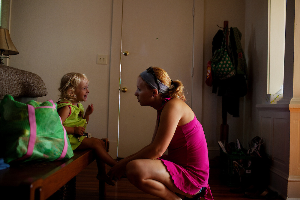 Melissa Eich, 23, works to get her daughter Madelyn Avery Eich, 2, ready to go to the beach on the afternoon of Saturday, September 4, 2010 in their home in Norfolk, Virginia.