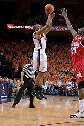 Virginia's J.R. Reynolds (2) shoots a three pointer over Maryland's Ekene Ibekwe (25).  The Cavaliers defeated the #22 ranked Terrapins 103-91 at the John Paul Jones Arena in Charlottesville, VA on January 16, 2007.