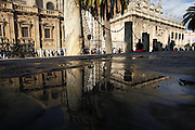 Crowds and reflections outside The Cathedral of Saint Mary of the See, Seville, Andalucia, Spain.<br /> Photo: Zute Lightfoot
