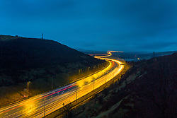 © Licensed to London News Pictures. 30/03/2018. Huddersfield UK. Picture shows bank holiday traffic travelling between Manchester & Leeds on the M62 near Huddersfield at dawn this morning. Photo credit: Andrew McCaren/LNP