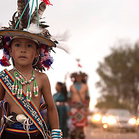 Jamual Allapowa with the Anshe: Kwe dancers waits for his turn to walk in the parade kicking off the Zuni Fair Friday.