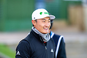 Haotong Li is all smiles on the first tee during the third round of the Alfred Dunhill Links Championship European Tour at St Andrews, West Sands, Scotland on 28 September 2019.