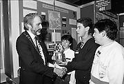 05/01/1989.01/05/1989.5th January 1989.The Aer Lingus Young Scientist of the Year Award at the RDS, Dublin..Picture shows Peter MacMenamin, President of the Teachers Union of Ireland presenting trophy to pupils from Firhouse Community College, Tallaght, Dublin from left Debbie Staunton, Kevin Whelan and Trevor McBride for their project 'The Wildlife of the Dodder Valley'.