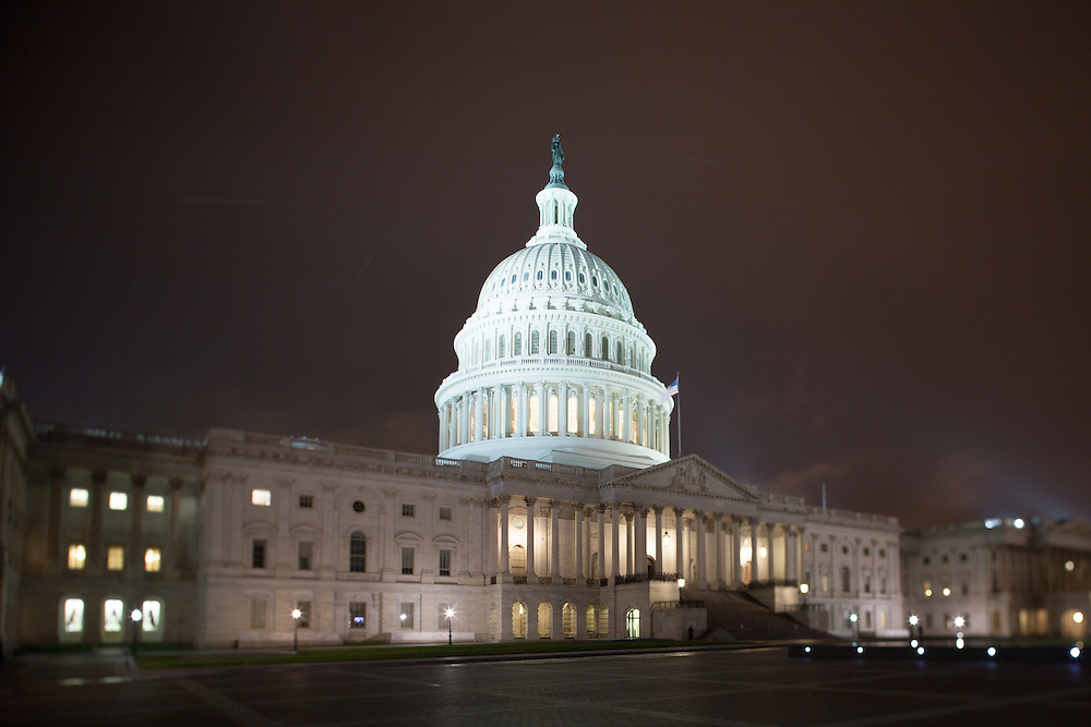 The United States Capitol building in Washington, DC is lit up beautifully at night on a cool spring evening.