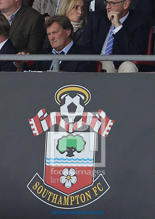 Glenn Hoddle ( centre R ) is seen in the stands during the Barclays Premier League match at the St Mary's Stadium, Southampton<br /> Picture by Paul Terry/Focus Images Ltd +44 7545 642257<br /> 27/09/2014