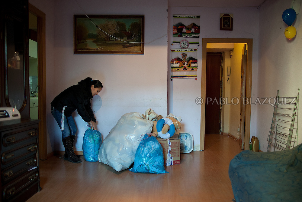 Patricia Tapia, 28, arranges her belongings while she waits to be evicted from her apartment on February 15, 2012 in Madrid, Spain. Tapia, an unemployed Ecuadorian mother of two, used to work at a mailing company but when she was six months pregnant the employer decided not to renew her contract and she could not afford to pay her mortgage. The anti-eviction organization 'Platform for People Affected by Mortgages' in Spain has called for a permanent halt to the evictions of families who are struggling to pay their debts because of the poor economic climate.
