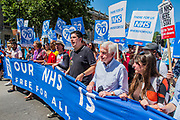 John McDonnell joins the front of the march as it passes Downing Street - #OurNHS70: free, for all, forever a protest and celebration march in honour of the 70 year history of the National Health Service. Organised by: The People's Assembly, Trades Union Congress, Unison, Unite, GMB, British Medical Association, Royal College of Nursing, Royal College of Midwives amongst others.