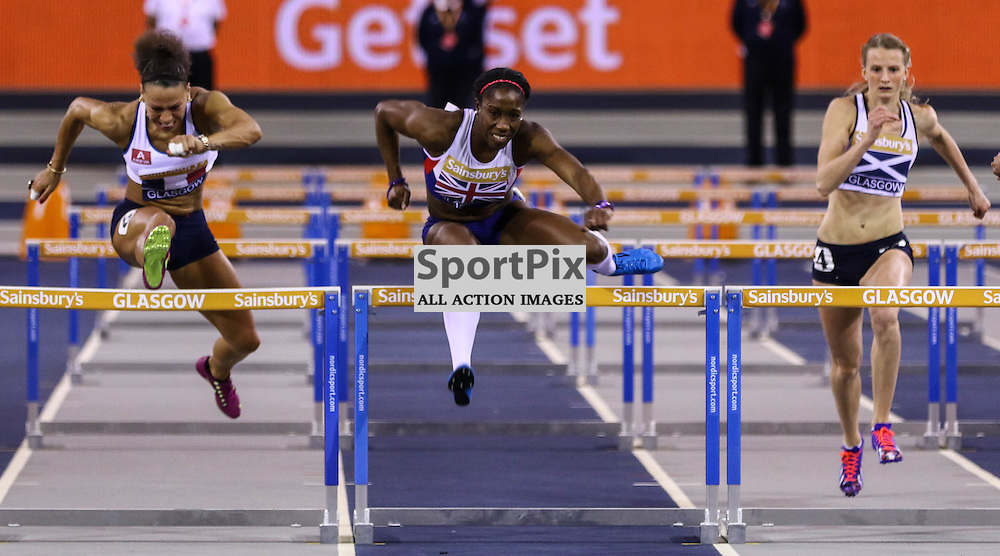 Serita SOLOMON (GBI) leads over the last hurdle from Cindy BILLARD (France) and Hazel ROSS (Scotland). Sainsbury's Glasgow International Athletics Match, 24 January 2015. (c) [Neil Bain] | SportPixPix.org.uk
