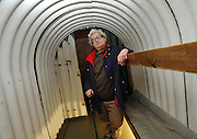 © Licensed to London News Pictures. 04/04/2012. London, UK. Gloria Sachs was eleven when she was evacuated from London to Cambridge for the duration of the war. She is pictured standing in an Anderson  Air Raid Shelter. Photo call and preview for the Imperial War Museum.s new A Family in Wartime exhibition. The exhibition features the life on the Home Front during the Second World War, explored through the eyes of one London based family, the Allpress.. Photo credit : Stephen SImpson/LNP