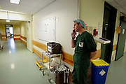 The Hague. Hospital. MCH. Medisch Centrum Haaglanden. A surgeon on the telephone..Photo: Gerrit de Heus