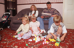 Family with young girl with Downs Syndrome playing with brother and sister,
