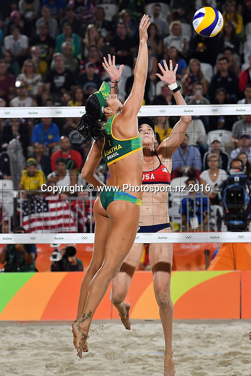 Brazil's Agatha Bednarczuk-Rippel (L) spikes the ball to USA's Kerri Walsh-Jennings during the Women's beach Volleyball semifinal in the volleyball arena on Copacabana beach at the 2016 Rio Olympics on Wednesday the 17th of August 2016. © Copyright Photo by Marty Melville / www.Photosport.nz