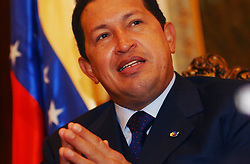 President Hugo Chavez of Venezuela gives an interview the day before the country holds a referendum that could revoke his mandate.  If Chavez loses the referendum his Vice President will run the government for 30 days when a new election would be held.  Analysts and pollsters say that the race is too close to call and any outcome could provoke violence and unrest in the world's 5th largest oil exporter.