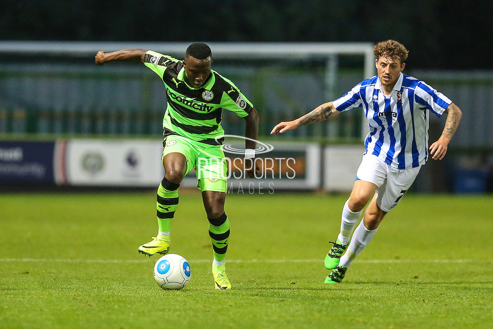 Forest Green Rovers Drissa Traore (4) and Cheltehham Town's Danny Whitehead during the Gloucestershire Senior Cup match between Forest Green Rovers and Cheltenham Town at the New Lawn, Forest Green, United Kingdom on 20 September 2016. Photo by Shane Healey.