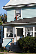 A homeowner escaped from the second floor of his own home during a home invasion on Benton Street in Rochester, New York on Friday, October 3, 2014.