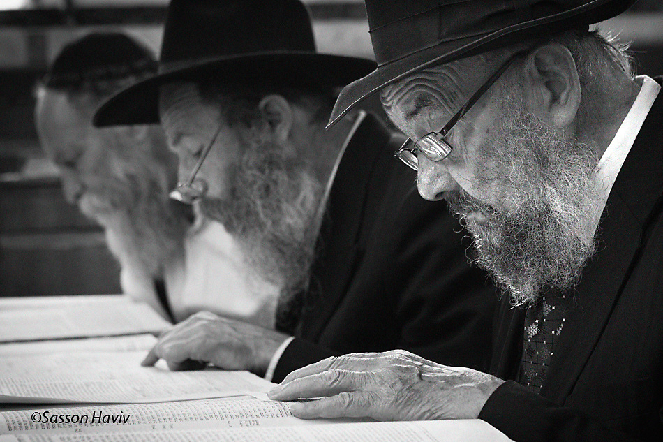 Three orthodox men studying at a synagogue in Jerusalem,Israel.