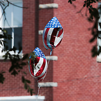 American flag balloons fly during the North Carolina 4th of July Festival Parade Friday July 4, 2014 in Southport, N.C.