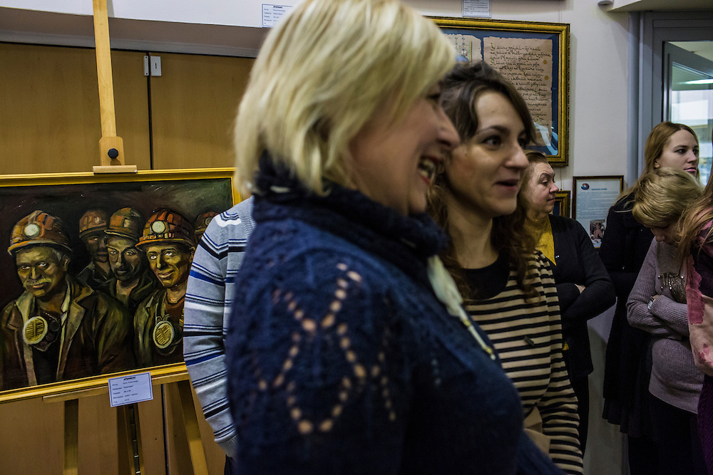 DONETSK, UKRAINE - JANUARY 29, 2015: Artist Kseniya Shevchenko, center right, attends the opening of a group art exhibition of which she is part entitled Hope, Belief, and Love in Donetsk, Ukraine. The exhibit showed the work of young local painters. CREDIT: Brendan Hoffman for The New York Times